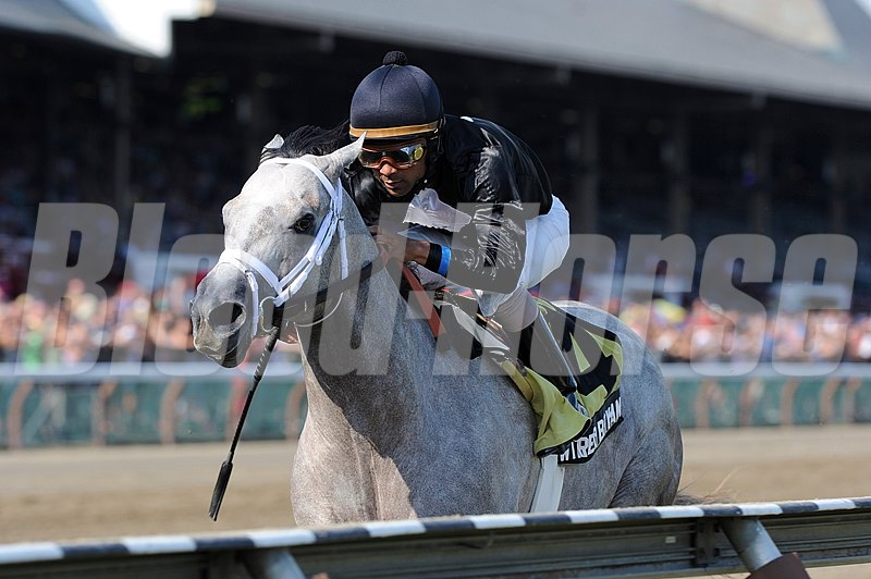 Wired Bryan and jockey Shaun Bridgmohan wins the Grade II Sanford Stakes at Saratoga.