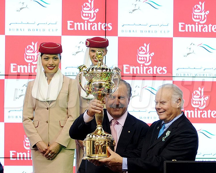 The majority partners for Animal Kingdom hold the Dubai World Cup trophy.