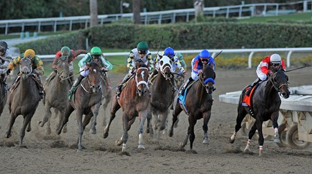 Mucho Macho Man (center) starts his move in the Breeders' Cup Classic stretch.