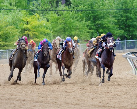 Final turn of the 2013 Preakness Stakes at Pimlico.