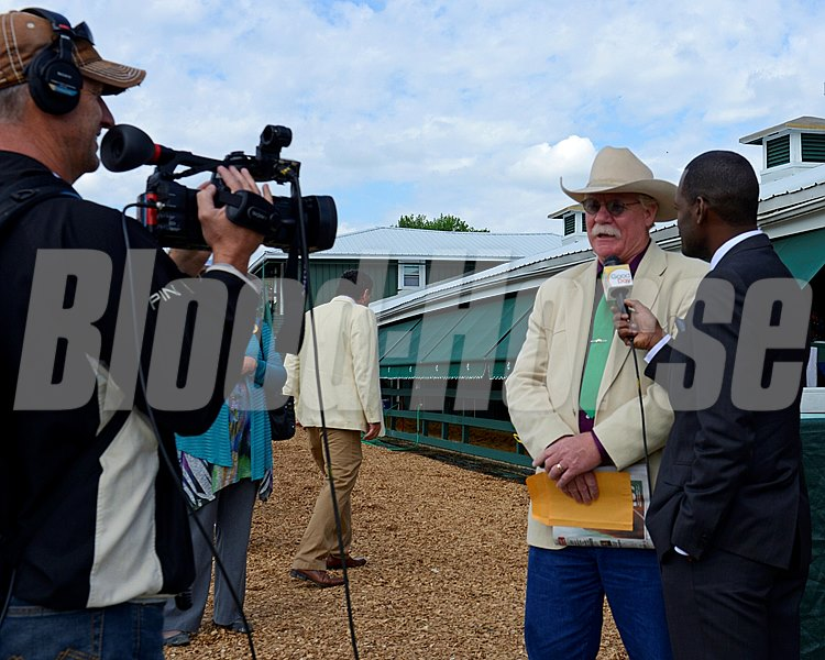 Caption: Ken Rudolph with Sacramento television crew interviews California Chrome owner Steve Coburn.