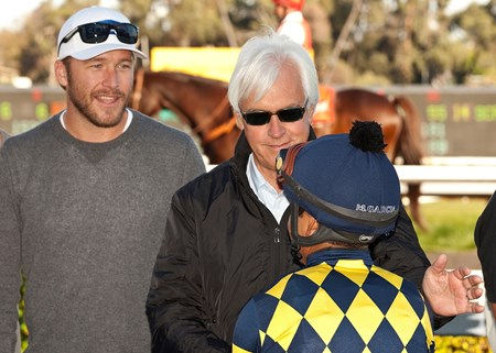 Owner Bode Miller and trainer Bob Baffert celebrate Carving's stakes victory.