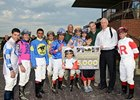 "John Velazquez celebrates win number 5,000, joined by his fellow jockeys and trainer Todd Pletcher.<br><a target=""blank"" href=""http://photos.bloodhorse.com/AtTheRaces-1/at-the-races-2013/27257665_QgCqdh#!i=2575389522&k=MsmC6Mh"">Order This Photo</a>"