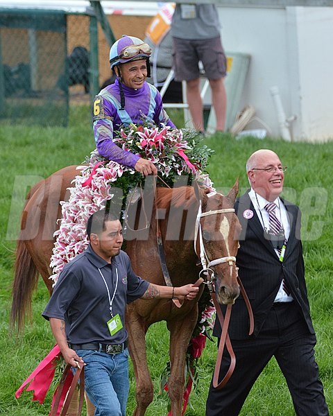 Jockey Mike Smith and Ed Stanco walk Princess Of Sylmar to the winners circle after the 2013 Kentucky Oaks.