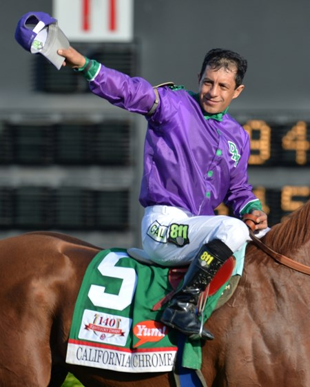 California Chrome with Victor Espinoza aboard wins the 2014 Kentucky Derby.