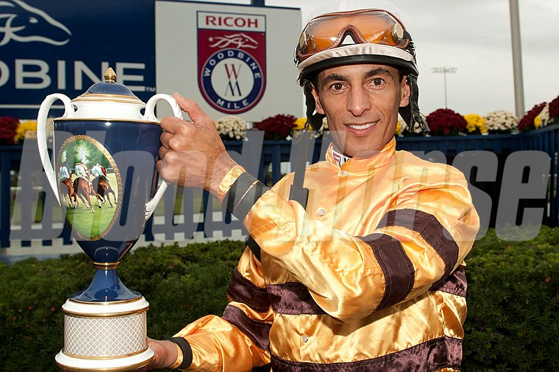 Jockey John Velazquez holds the Ricoh Woodbine Mile trophy after guiding Wise Dan to victory in the $1,000,000 dollar race.