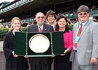 The Ramseys' win in the Elkhorn Stakes marked their eighth graded stakes victory, for which they earned a gold tray.