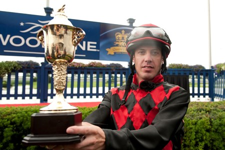 Toronto Ont.July 7,2013.Woodbine Racetrack.Jockey Jesse Campbell holds the Queen's Plate trophy after  guiding Midnight Aria  to captures the Queen's Plate Stakes. michael burns photo