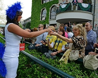 A Hansen girl interacting with the Hansen fans in the Keeneland crowd as the Blue Grass Stakes approaches.