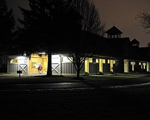 UNDER LIGHTS: Breeding season has begun, so a common sight is mares under lights, such as this barn at Stonestreet Farm in Kentucky.