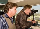 Trevor Denman (left) watches as Conan O'Brien calls the second race at Santa Anita Oct. 25.