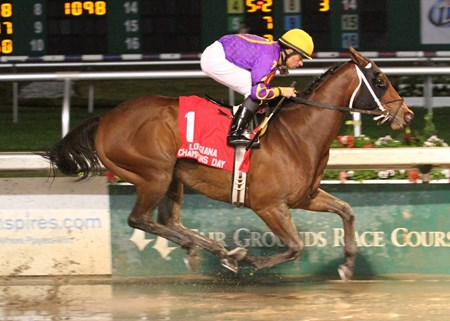Raiseanothergator with Richard Eramia aboard draws away in the slop to easily win the Louisiana Champions Day Handicap Stakes at Fair Grounds Race Course & Slots in New Orleans.