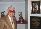 John Nerud visits the National Museum of Racing to see the collection of trophies and paintings he recently donated.