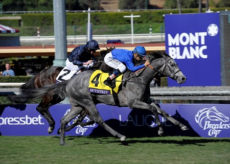 Outstrip with jockey Mike Smith roars to the front past Giovanni Boldini in the Breeders' Cup Grade I Juvenile Turf.