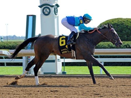 Jack Swain III's homebred Miss Ella went from debut winner last month to graded stakes winner with a victory in the Grade II $250,000 Adena Springs Beaumont Stakes at Keeneland.