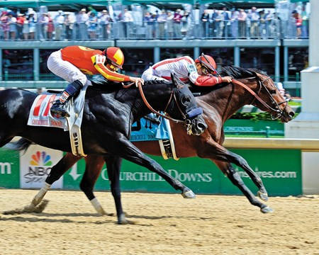 Central Banker outfinishes Shakin It Up to win the Grade II Churchill Downs Stakes.