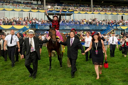 Toronto Ont.July7,2013.Woodbine Racetrack.Queen's Plate Stakes Midnight Aria Jockey Jesse Campbell walk into the winner 's circle with owners (L-R)Lou Tucci  and Carlo Tucci. michael burns photo