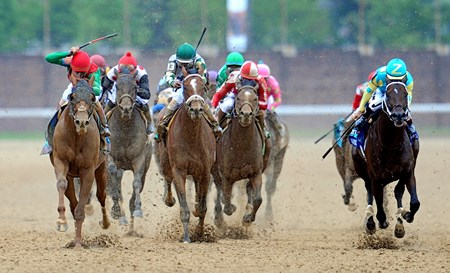 Team Valor's Animal Kingdom (red cap) John Velazquez up, wins the 137th Kentucky Derby. Nehro (far right) finished second and Mucho Macho Man (center) was third.