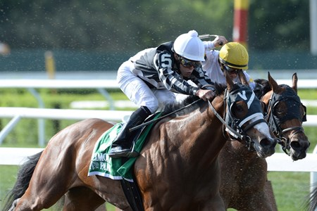 New York-bred Hot Stones jumped back into open company to make her graded stakes debut, and emerged an upset winner of the $150,000 Grade III Bed o' Roses Handicap at Belmont Park.