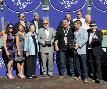 The connections of Ria Antonia receive awards for their victory in the Breeders' Cup Juvenile Fillies.