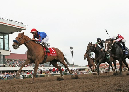 Mister Marti Gras and jockey Francisco Torres ride to victory in the Mystic Lake Mile at Canterbury Park in Shakopee, Minnesota.