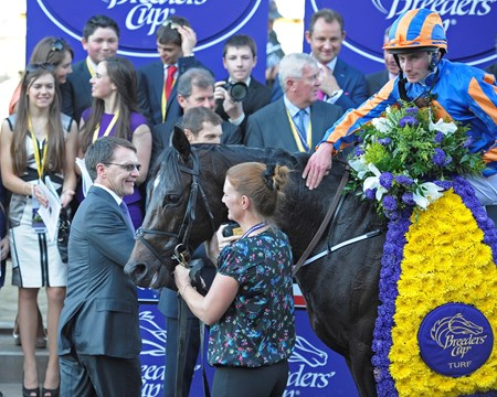 Caption: Aidan O'Brien with horse in winner's circle.
