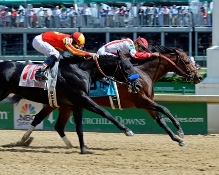 Caption: Central Banker with Corey Nakatani wins the Churchill Downs (gr. II) with Shakin' It Up and Mike Smith in second.
