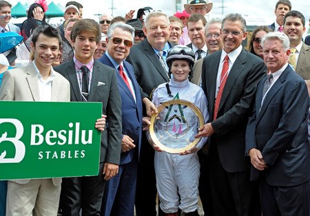 Rosie and the winning connections pose for a photo in the Winner's Circle.