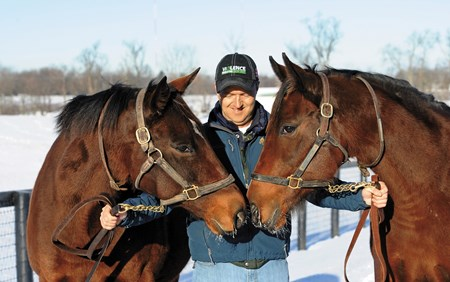 Dell Ridge Farms' Des Ryan, holding broodmares, Run Kate Run (L) and her daughter Kid Kate in 2014.