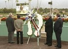 Oak Tree Racing Association and Santa Anita Park honored legendary John Henry between races Saturday, Oct. 13, 2007, with a tribute which included at video presentation.  John Henry passed away on Monday, and in the Santa Anita winner's circle to honor the champion were, from left, John Henry's groom (Jose Mercado), exercise rider (Lewis Cenicola), assistant trainer Eduardo Indo, and his Hall of Fame trainer, Ronald McAnally.