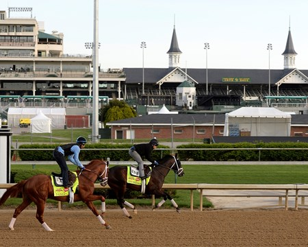 Caption: Danza, left, and Vinceremos prepare to start their work in front of the historic TwinSpires.