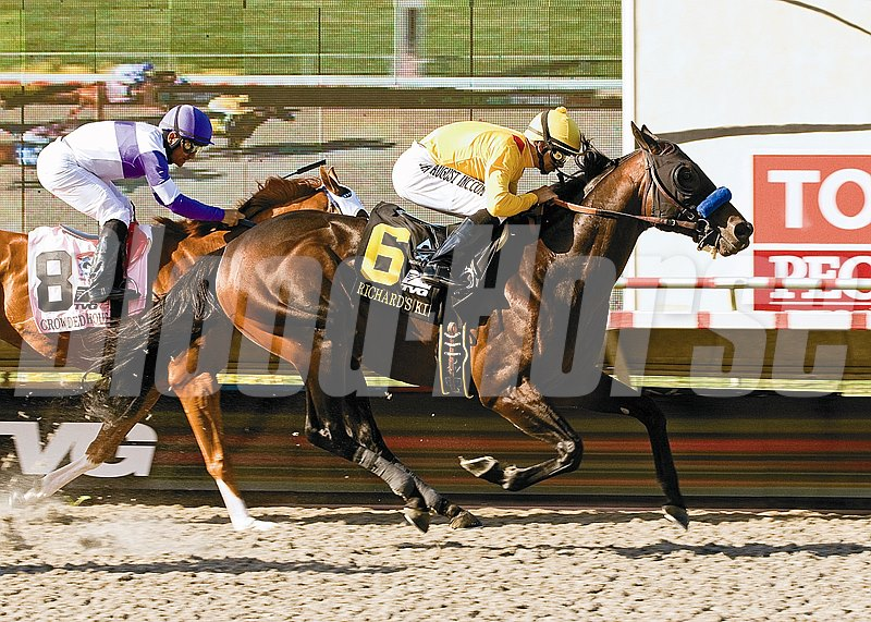 Richard's Kid and jockey Mike Smith, right, outrun Crowded House (Corey Nakatani), left, to win the Grade I, $1,000,000 Pacific Classic for the second consecutive year, August 28, 2010 at Del Mar Thoroughbred Club, Del Mar CA.