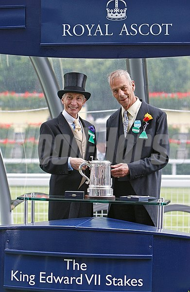 Charlie Watts, of the Rolling Stones, presents to Henry Cecil for Father Time's win in the King Edward VII Stakes at Royal Ascot June 19, 2009.