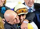Charles Fipke embraces jockey John Velazquez after a victory aboard Lady Shirl.