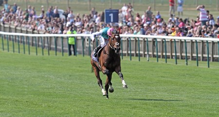 Frankel, ridden by Tom Queally, wins the Qipco 2,000 gns. with ease at Newmarket .