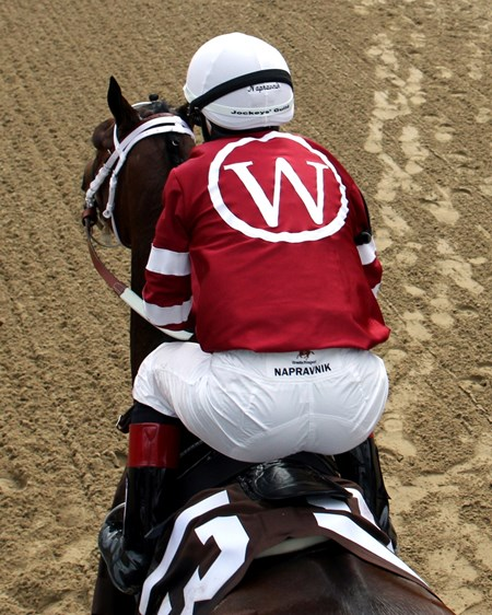 Rosie Napravnik wearing Winchell Thoroughbreds silks aboard Untapable.
