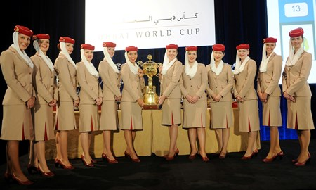 Emirates girls at the post draw with the Dubai World Cup Trophy.