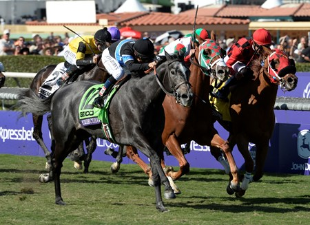 Mizdirection, with jockey Mike Smith, comes up on the outside to win the Breeders' Cup Turf Sprint at Santa Anita Park in Arcadia, CA November 2, 2013.