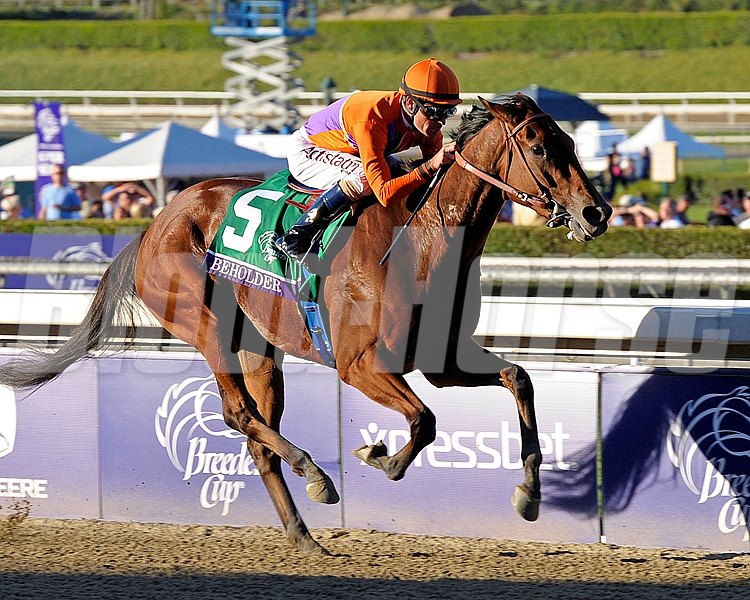 Beholder with Gary Stevens up charge towards the finish line in the Grade I Breeders' Cup Distaff.