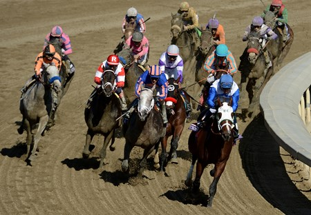 Horses round the final turn in the Breeders' Cup Juvenile at Santa Anita.