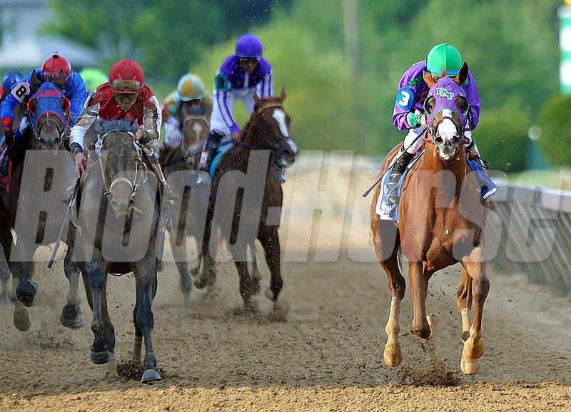 California Chrome enters the light of the finish line.