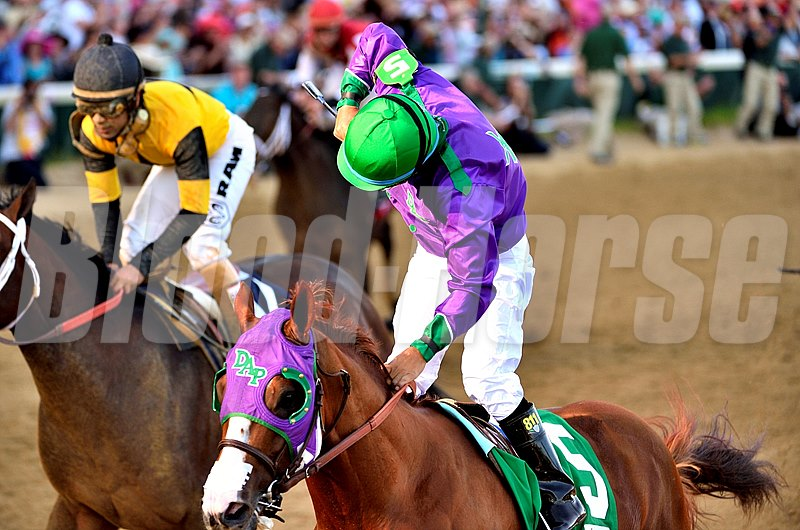 Victor Espinoza giving a fist pump after winning the 140th Kentucky Derby on California Chrome.