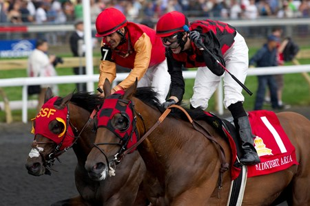 Toronto Ont.July7,2013.Woodbine Racetrack.Jockey Jesse Campbell guides Midnight Aria (inside)tovictory over Up With the Birds(Outside ) in the Queen's Plate Stakes at Woodbine.Midnight Aria is owned by Tucci Stables and trained by Nick Gonzalez. michael burns photo