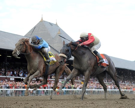 V. E. Day upset stablemate and Jim Dandy (gr. II) winner Wicked Strong by a nose in the 1 1/4-mile 'Midsummer Derby' Aug. 23 at Saratoga Race Course. He came charging late to surge ahead for his biggest career victory at odds of 19-1.