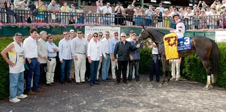 Royal Delta and jockey Mike Smith in the winner's circle for after the 2013 Delaware Handicap (G1) at Delaware Park on July 20, 2013.