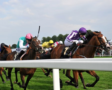 Leading Light leads the way to win the Queen's Vase at Royal Ascot.
