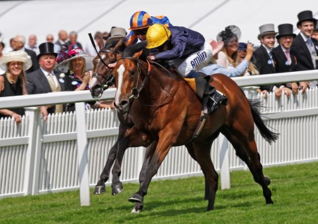 Hillstar (yellow cap) wins the King Edward VII Stakes with Battle of Marengo (obscured) on June 21, 2013.