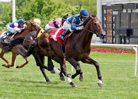 Keep Up and jockey James Graham wins the Swoon's Son Stakes at Arlington Park.