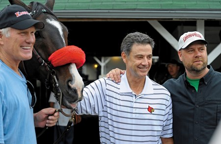 University of Louisville basketball coach Rick Pitino, a two-time NCAA champion,  has co-owned horses such as A P Valentine and Goldencents. He is shown with Hall of Fame quarterback Terry Bradshaw and trainer Doug O'Neill.