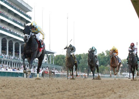 Funny Proposition (far left in blinkers) defeated favored Royal Delta (on rail, B on cap) in the 2013 Fleur de Lis Stakes at Churchill Downs.